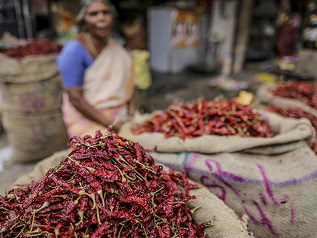 Sacks of dried chillies sit on display at a spice store in Thiruvananthapuram, Kerela, India, on Sunday, May 31, 2015. While consumer-price gains eased to a four-month low of 4.87 percent in April, this quarter's rebound in oil prices and a potentially weak monsoon threaten to stoke inflation. Photographer: Dhiraj Singh/Bloomberg