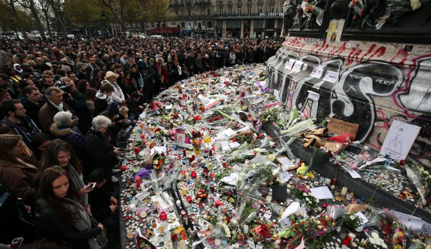 PARIS, FRANCE - NOVEMBER 16:  People observe a minute-silence at the Place de la Republique in memory of the victims of the Paris terror attacks last Friday, on November 16, 2015 in Paris, France. Countries across Europe will join France, currently observing three days of national mourning, in a one minute-silence today in an expression of solidarity with the victims of the terrorist attacks, which left at least 129 people dead and hundreds more injured.  (Photo by Christopher Furlong/Getty Images)